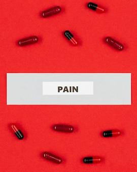 Pílulas de analgésico na mesa