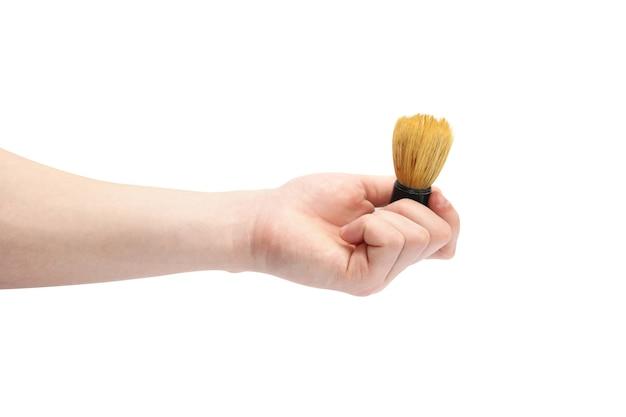 Pincel de barbear na mão