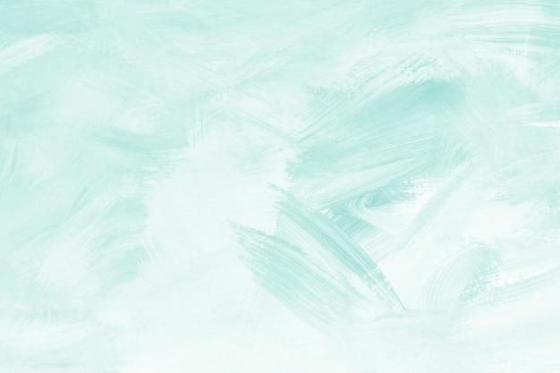 Pincel de pintura verde com textura de fundo