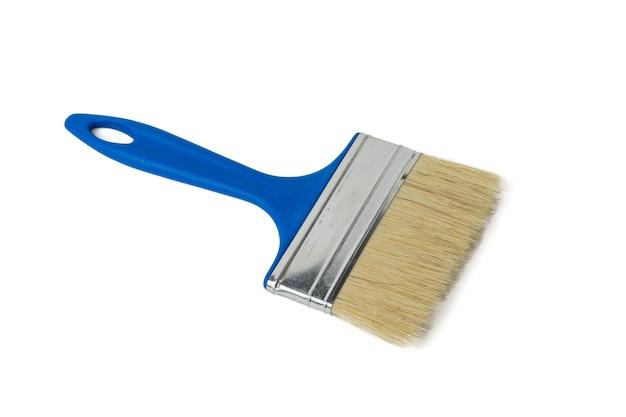 Pincel largo isolado em uma superfície branca. materiais para pintura.