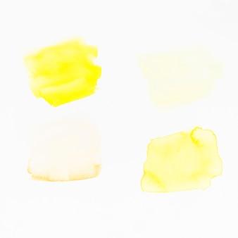 Pinceladas amarelas sobre fundo branco