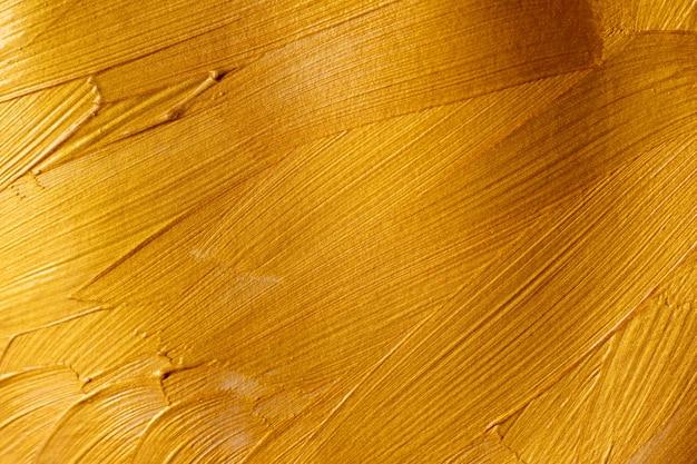 Pinceladas de tinta dourada abstrata textura de fundo