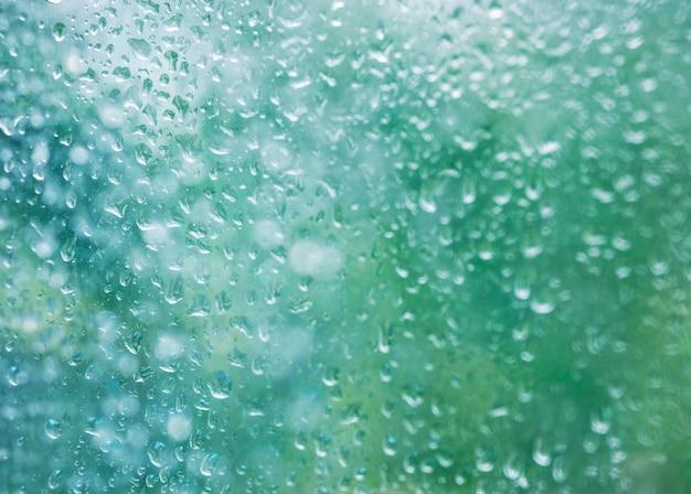 Pingos de chuva na temporada de chuva de fundo de textura de janela de vidro