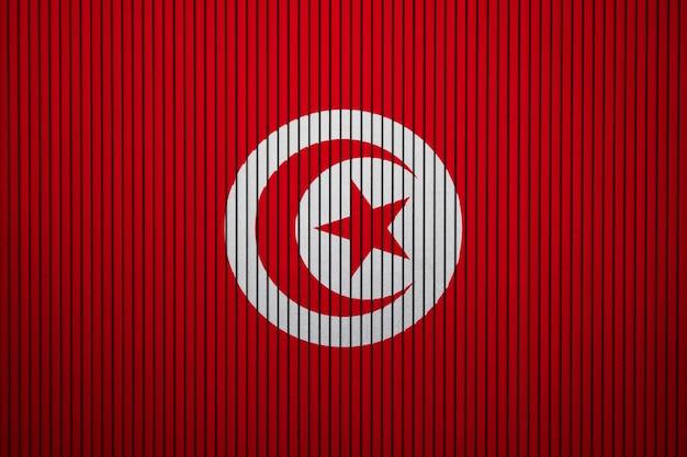 Pintado a bandeira nacional da tunísia em uma parede de concreto
