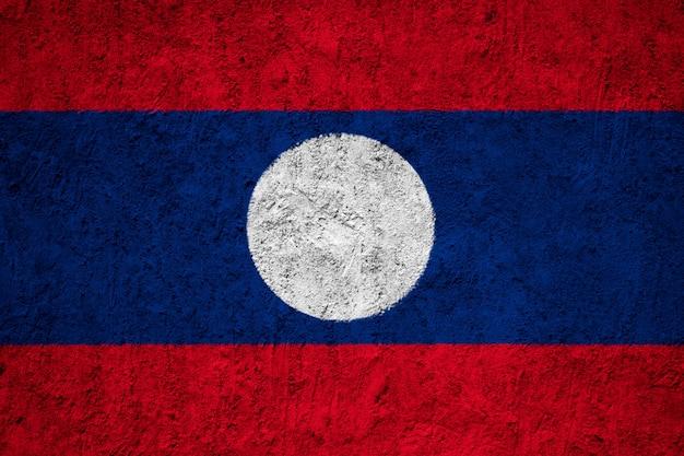 Pintado a bandeira nacional do laos em uma parede de concreto