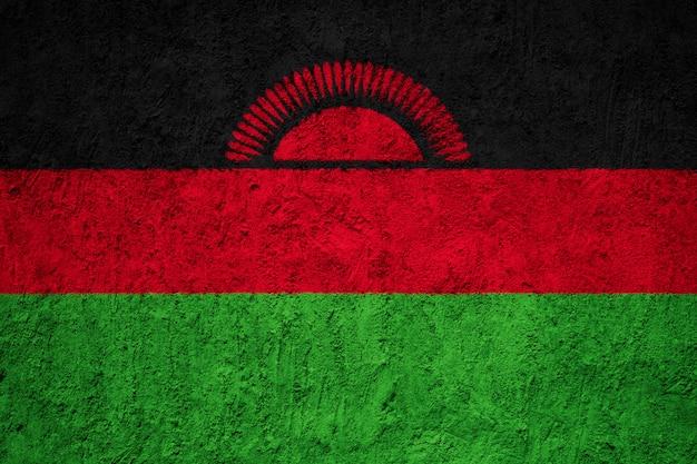 Pintado a bandeira nacional do malawi em uma parede de concreto