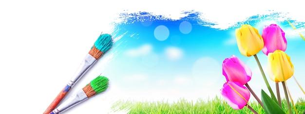Pintando a paisagem de primavera. pincele com tinta azul sobre o céu e o campo verde.