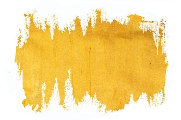 Pinte traços dourados da textura da cor do traçado do pincel com espaço para seu próprio texto