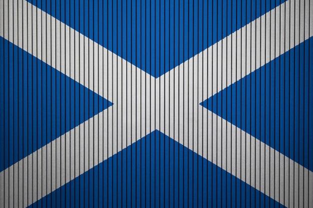 Pintou a bandeira nacional da escócia em uma parede de concreto