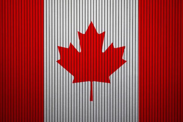 Pintou a bandeira nacional do canadá em uma parede de concreto