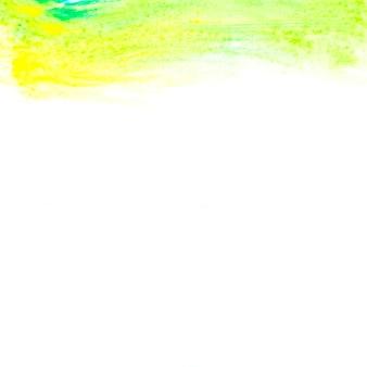 Pintura amarela e verde abstrata em papel