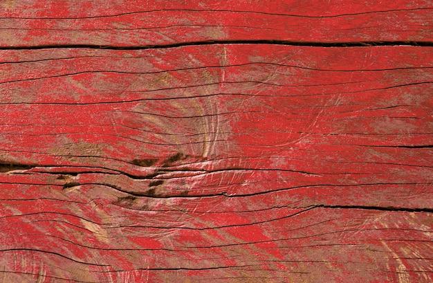 Pintura da casca da cor vermelha na textura de madeira do fundo da tabela do vintage.