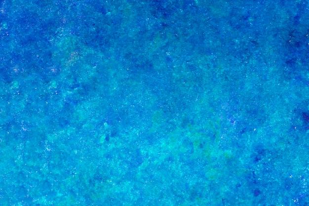 Pintura de cor azul abstrata. grunge projetado na textura da parede
