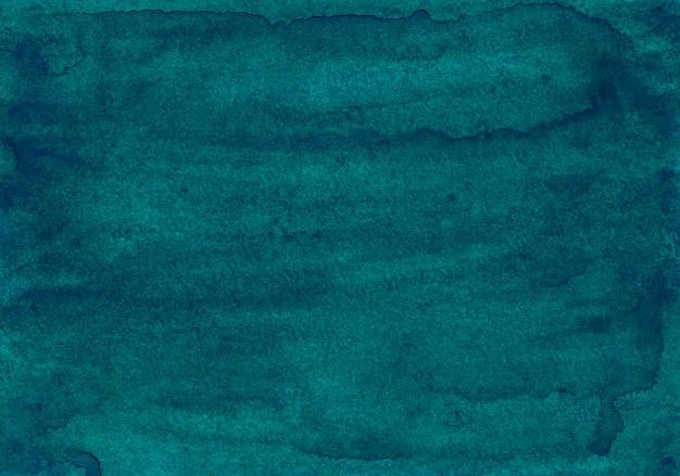 Pintura em aquarela fundo azul esverdeado profundo. aquarelle verde mar pintado à mão. manchas na textura de papel.