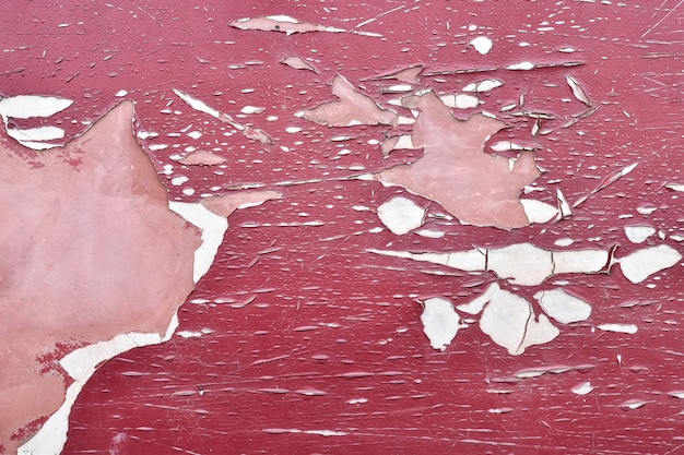 Pintura velha da casca e cor vermelha rachada.