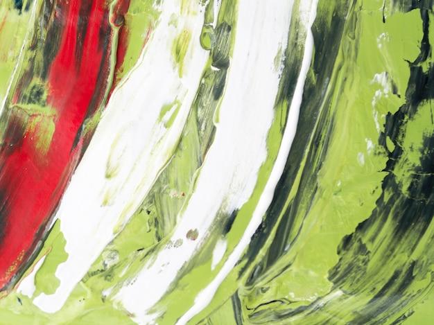 Pintura verde minimalista com traços vermelhos e brancos
