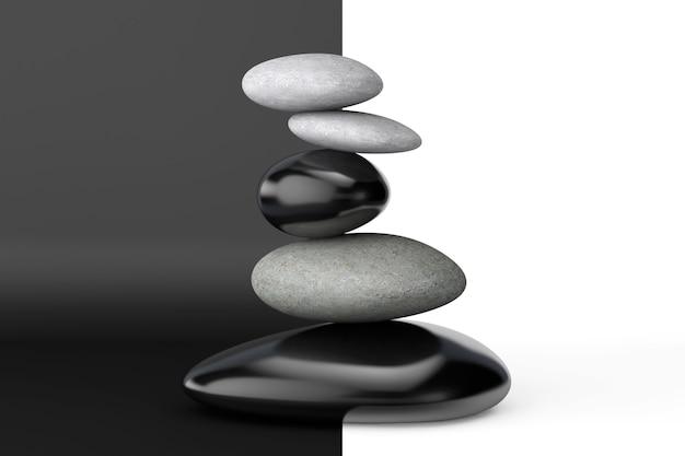 Pirâmide das pedras equilibradas em um fundo branco e preto