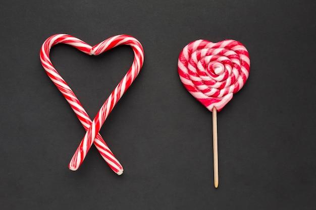 Pirulito e coração de bastões de doces