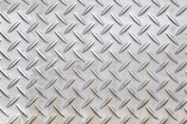 Piso de aço texturizado e plano de fundo.