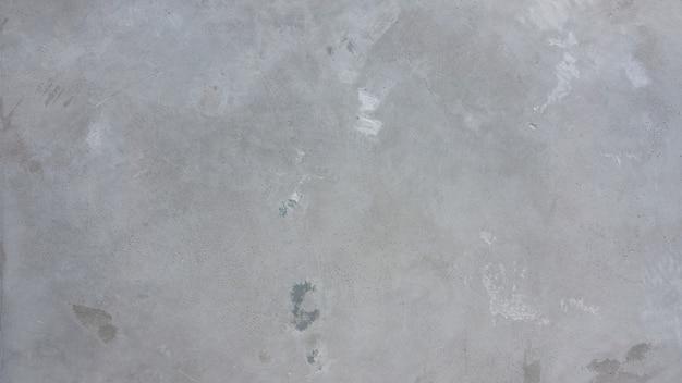 Piso de cimento de concreto e superfície de fundo de textura áspera velha e cor cinza.