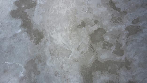 Piso de cimento de concreto e superfície de textura de fundo áspero velho e cor cinza.