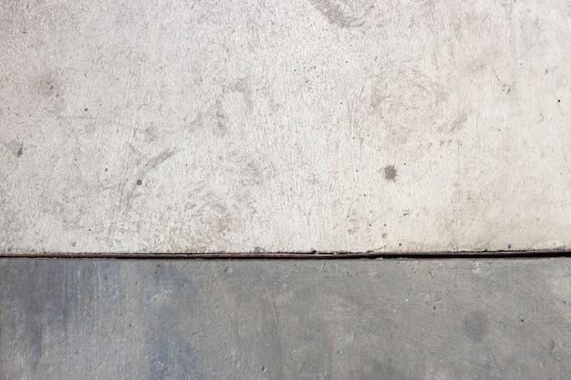 Piso de concreto closeup fora do edifício da fábrica, fundo industrial
