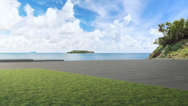 Piso de concreto da estrada e grande jardim com vista para o mar ilustração 3d de gramado verde vazio