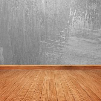 Piso de madeira com uma parede de concreto