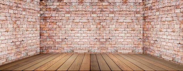 Piso de madeira e parede de tijolos, quarto vazio