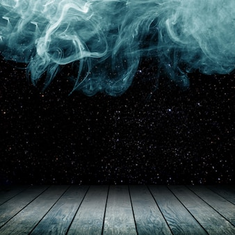Piso de madeira tendo como pano de fundo nuvens de fumaça