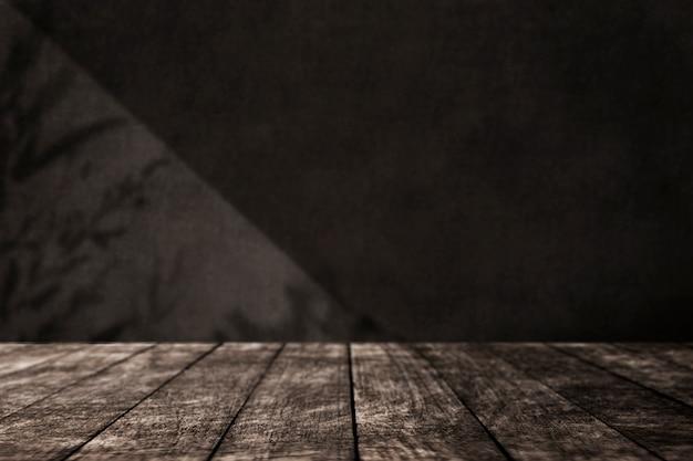 Piso de madeira vazio com parede preta em estilo loft