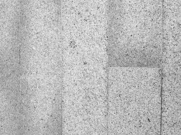 Piso de material de concreto de pedra de cor cinza e textura velha e vista superior para o fundo.