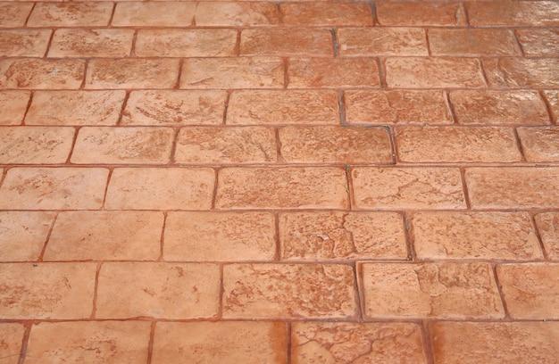 Piso de tijolos de pavimentação ou fundo de trilha de pedra de pavimentação vermelha