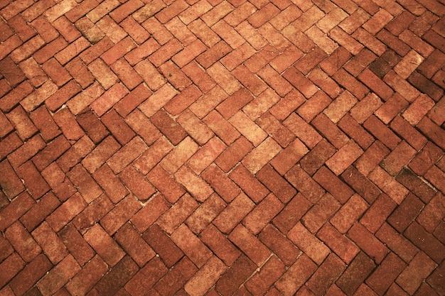 Piso de tijolos em tons de laranja escuro antigo, pedras do pavimento, interiores de azulejos de parede de luxo