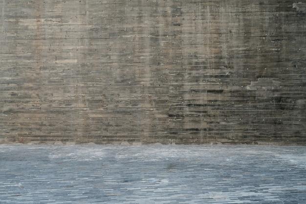 Pisos de madeira vazios e paredes cinzentas são ao ar livre