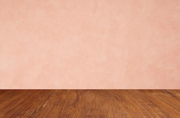 Pisos de madeira vazios no fundo da parede rosa