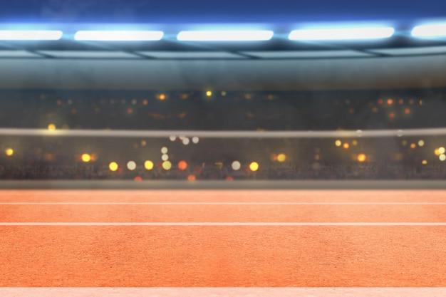 Pista de corrida e tribuna com luzes desfocadas