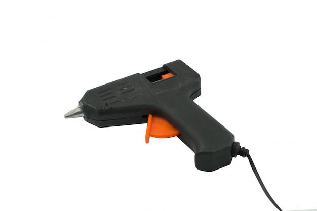 Pistola de cola isolada no branco