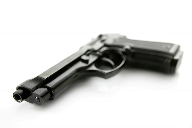 Pistola de mão negra sobre