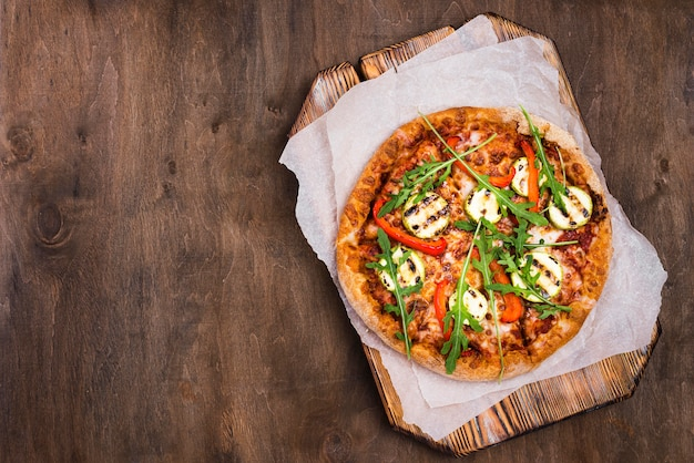 Pizza de rúcula deliciosa leigos plana