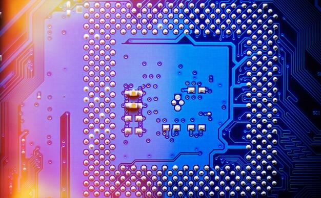 Placa de circuito eletrônico close-up. padrão de fundo abstrato.