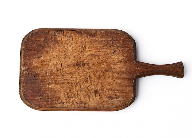 Placa de corte vintage muito antiga com um identificador de carvalho