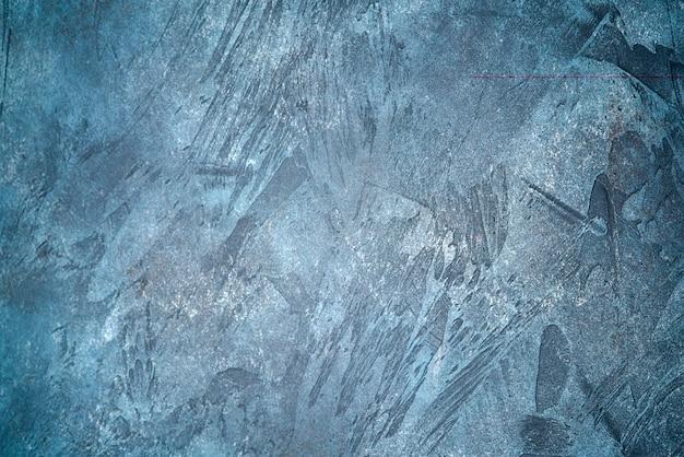 Placa de madeira azul texturizada.