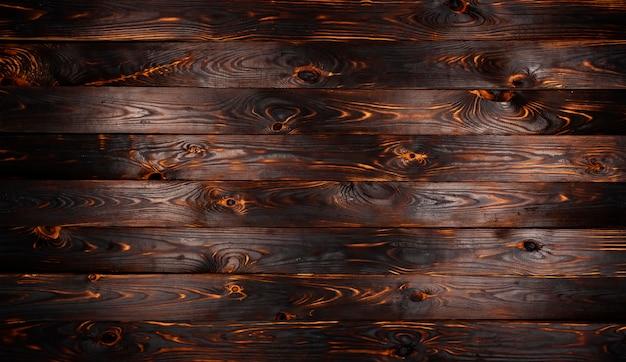 Placa de madeira queimada, textura de madeira de carvão preto