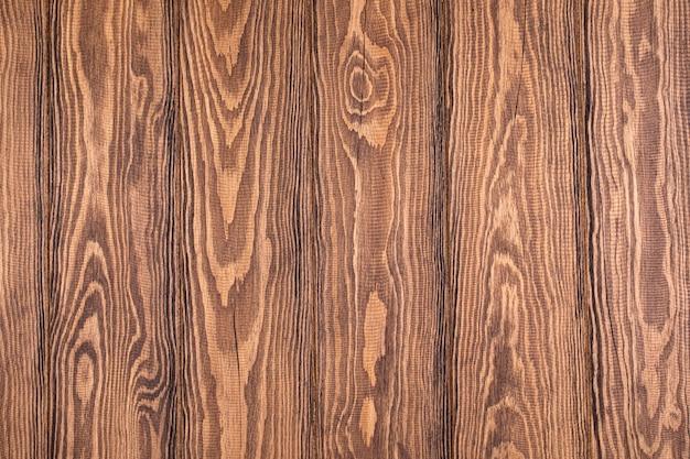 Placa de madeira texturizada. fundo marrom para fotos. tábua de parquet.