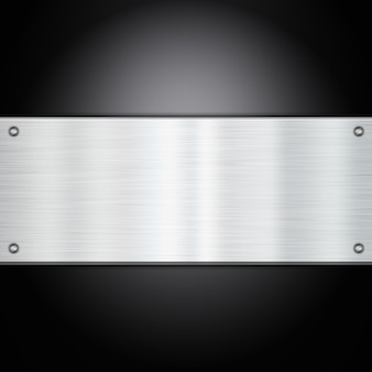 Placa de metal brilhante em um fundo de fibra de carbono