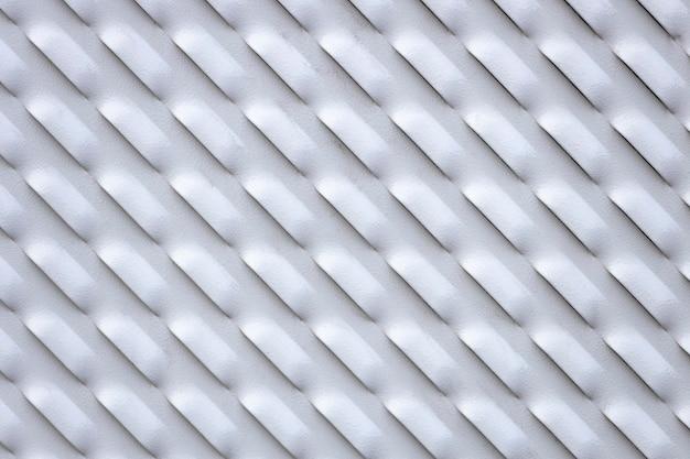 Placa de metal cinza com orifícios. parede metálica com ventilação. foto de alta qualidade