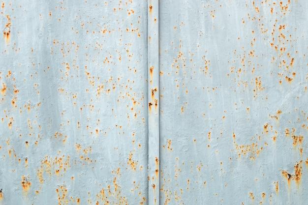 Placa de metal enferrujada com textura de superfície pintada velha