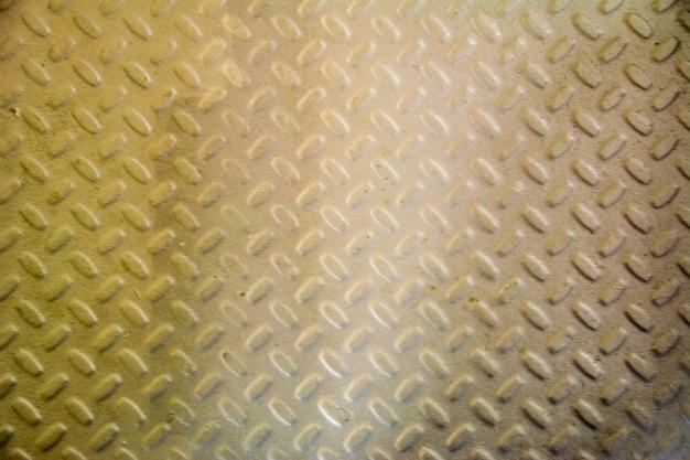 Placa de piso de metal com padrão de diamante. fundo de textura de chapa de aço