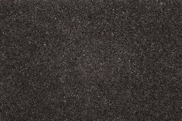 Placa de textura de espuma preta. fundo de material de borracha macia.